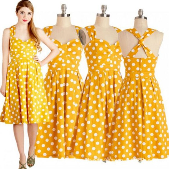 The yellow polka dot dress is so vibrant I went with some gold tier earrings that was accented with orange and my tan low block heels because they look a little .