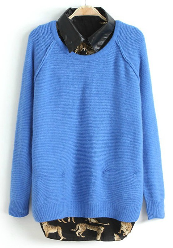 A bright blue hue gives cool appeal to this leopard-print, mohair-blend sweater. Crew neck. Long sleeves. Ribbed trims. Pullover style and relaxed fit.