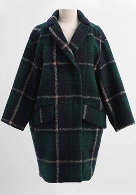 When you are looking for a coat that will get attention, this original design of ours is the one! From the tailored form-fitting structure of the bodice to the flirty tiered asymetrical skirt to the beautiful dark green color, this soft wool coat is truly one of a kind.