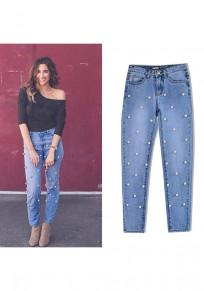 Blaue Flickwerk Pearl Taschen Knöpfe Reißverschluss hoch taillierte lange Jeans