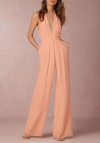Combinaison femme jambes évasé licou dos nu décolleté plongeant élégant de soirée rose