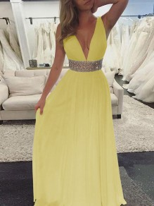 Maxi dress partito con scollo A V A pieghe con paillettes giallo