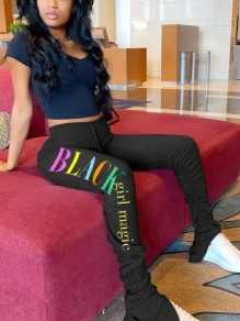 "Pantalone lungo stampa ""black girl magic"" coulisse pieghe casual A pieghe A vita alta nero"